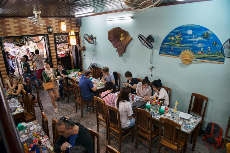 Eating banh mi sandwiches at the famous Banh Mi Phuong