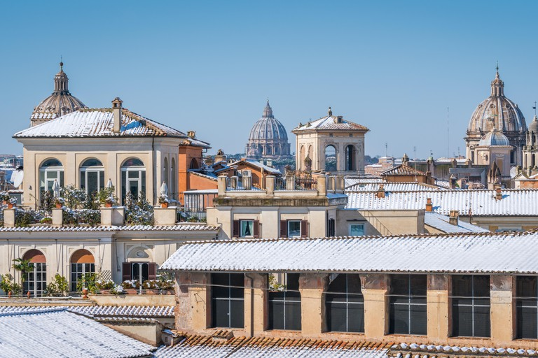 Snow in Rome in February 2018, panoramic sight of roofs covered in snow from the Caffarelli Terrace on the Capitoline Hill.