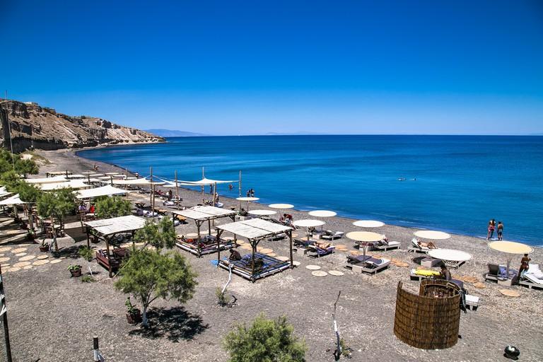 Santorini, Greece- June 12, 2016: Black beach of Exo Gialos Thiras on Santorini island, Greece.