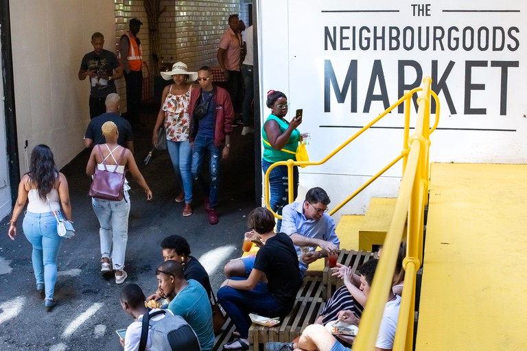 People walking in and out of the Neighbourgoods market