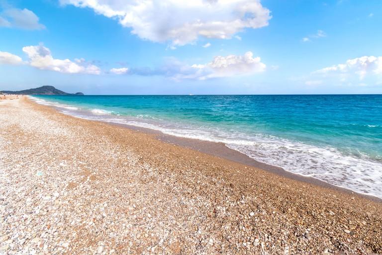 View of Afandou beach near Faliraki, bluy sky, clouds, (Rhodes, Greece)