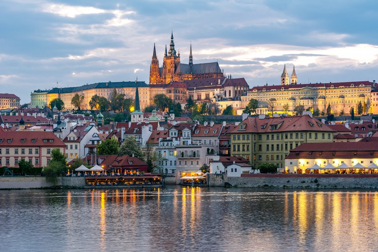 Prague Castle with St. Vitus Cathedral over Lesser town (Mala Strana) at sunset, Czech Republic