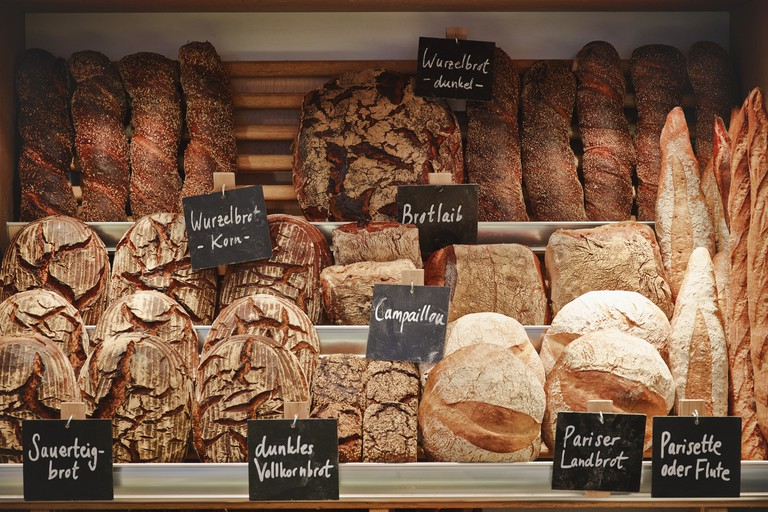 Various breads displayed in shelves