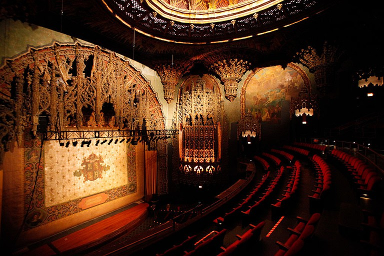 LOS ANGELES, CA - FEBRUARY 07, 2014:  The stage curtain and elaborate proscenium arch surrounding th