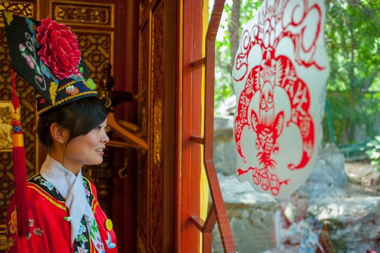 A waitress dressed in a historic costume at the Bai Jia Da