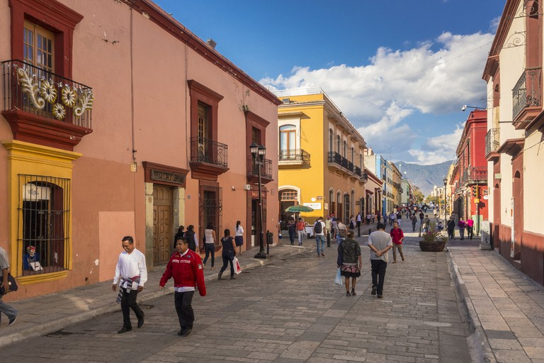 People walking on Calle Alcala, a pedestrian street in center Oaxaca City Mexico
