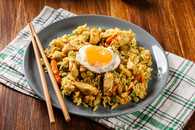 Fried rice nasi goreng with chicken egg and vegetables
