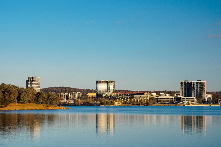 Buildings by lake in Ginninderra, Australia