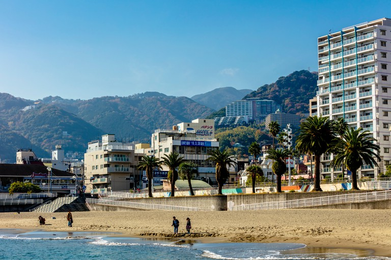 Cityscape view of Atami beach and city centre, Japan.