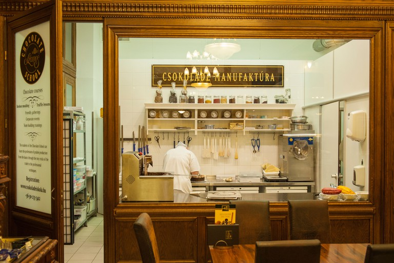 Budapest Hungary ,Szamos Csokolade Iskola cafe tiled mural picture traditional jam confection makers chocolate making room