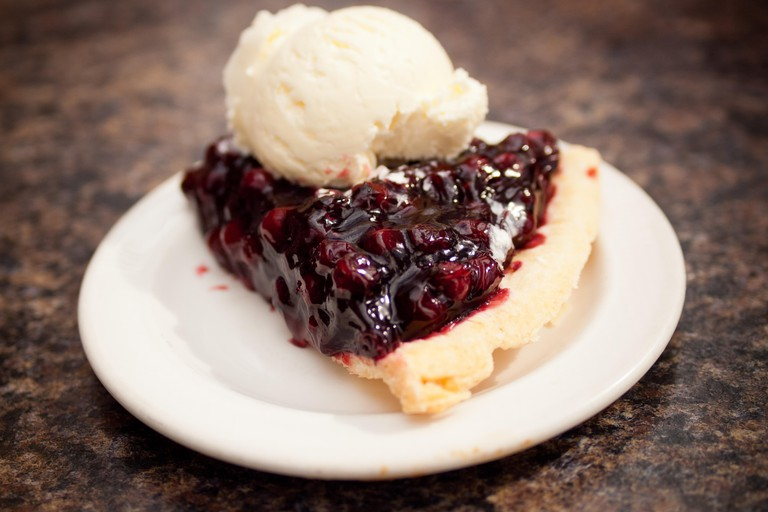 A slice of Saskatoon berry pie and a scoop of vanilla ice cream from the Berry Barn in Saskatoon, Saskatchewan, Canada.