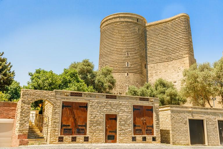 Azerbaijani stone buildings with  Gız Galası medieval Maiden tower, old town, Baku, Azerbaijan