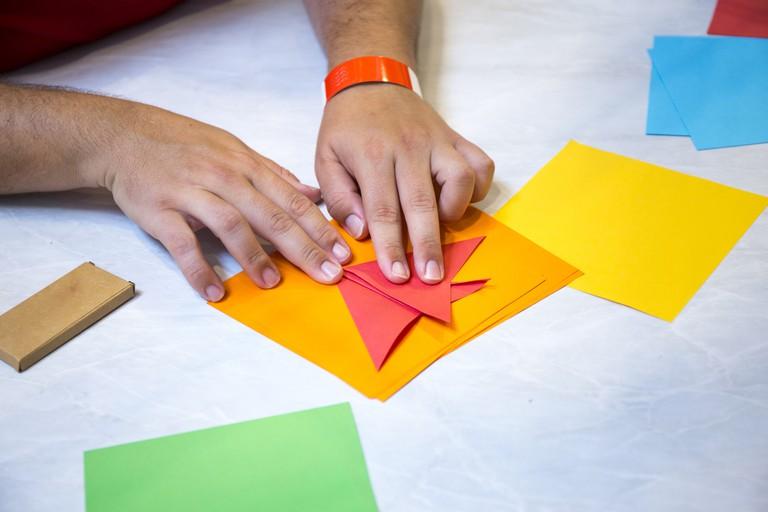 A man folding origami paper
