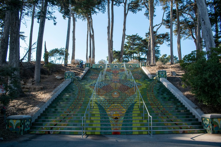 The Lincoln Park Steps in San Francisco, CA are covered with colorful tile in the shape of a flower.
