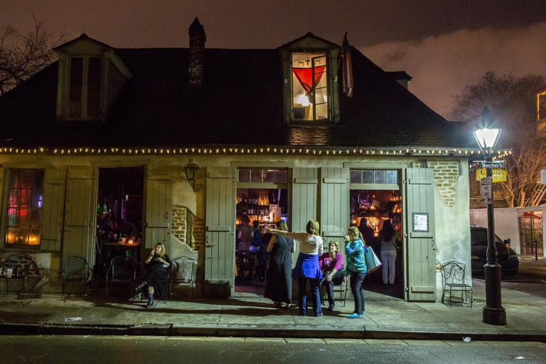 French Quarter, New Orleans, Louisiana.  Night Scene, Jean Lafitte's Blacksmith Shop Bar, Bourbon Street.  Built between 1722-32