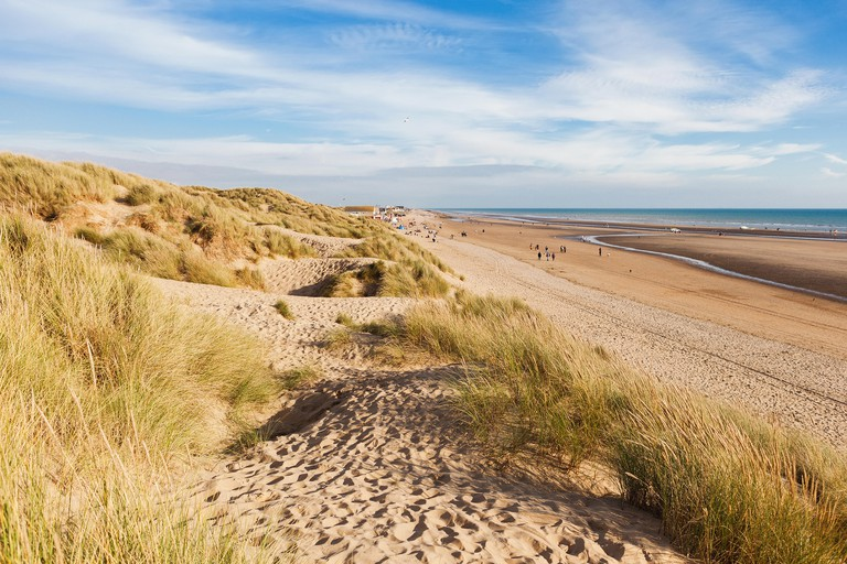 Camber Sands, sandy beach at the village of Camber, East Sussex near Rye, England, the only sand dune system in East Sussex. View of the dunes, grass