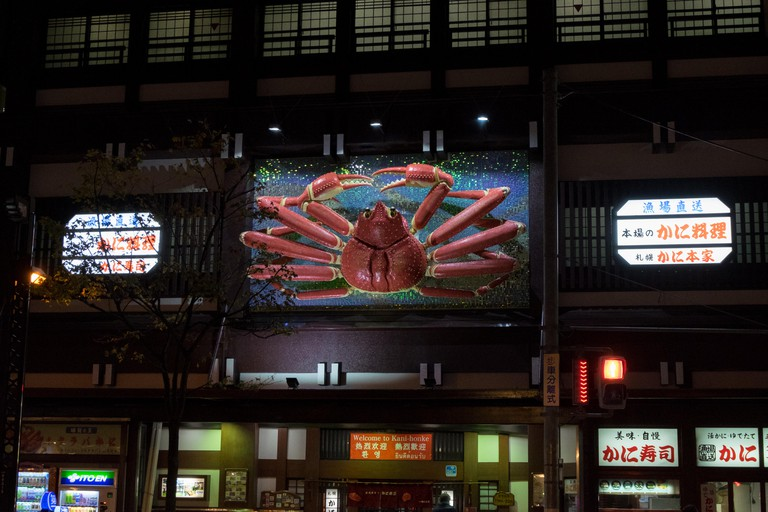 The restaurant Kani Honke at night in Sapporo, Japan.