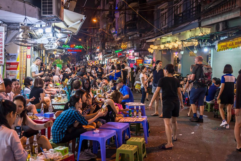 Busy Bia Hoi Junction famous for street food restaurants at night in the Old Quarter, Hanoi, Vietnam