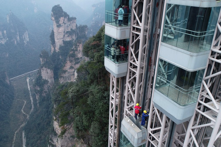 Beijing, China's Hunan Province. 24th Jan, 2019. Maintenance workers check the operating status of the 326-meter Bailong Elevator, the world's highest outdoor elevator, at the Wulingyuan Scenic Area in Zhangjiajie, central China's Hunan Province, Jan. 24,