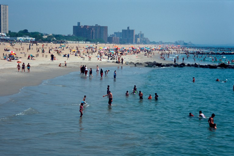 Coney island beach with bathers in the sea, seen from the Steeplechase pier, Coney Island, Brooklyn, New York City, USA