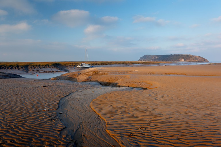 Beach at Uphill and River Axe Estuary with Brean Down in the Distance. Weston-super-Mare, Somerset, England, UK.