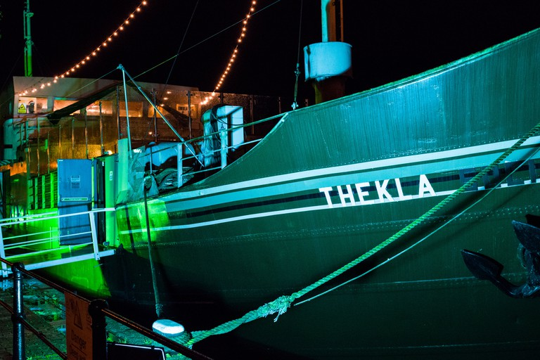 The Thekla nightclub and music venue floodlit at night, The Grove in Bristol Harbour, England.
