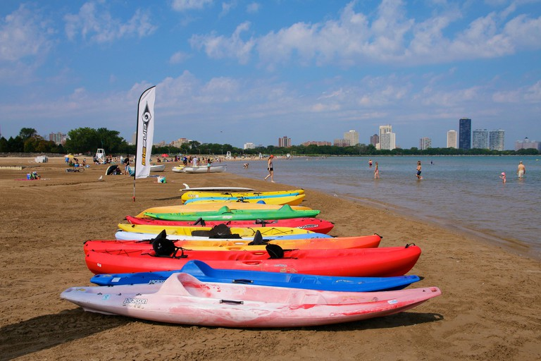 Chicago, USA, 3rd September 2015. Colorful rental kayaks line Montrose Beach at Lake Michigan on this steamy early September day. Temperatures exceeded 90ºF/32ºC but few people could cool off in the lake on a weekday. Credit:  Todd Bannor/Alamy Live News