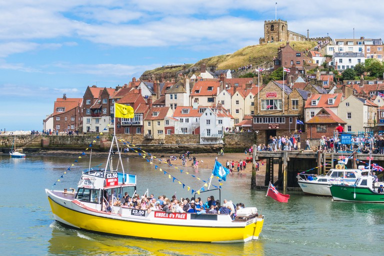 whitby harbour town abbey ruins and small boats whitby yorkshire england uk gb eu europe