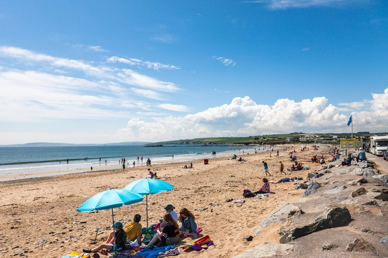 Garrylucas, Cork, Ireland. 13th June, 2020. On the first weekend since the Covid-19 restrictions were lifted, crowds took advantage of the sunny weather to head to the beach at Garrylucas, Co. Cork, Ireland. - Credit; David Creedon / Alamy Live News