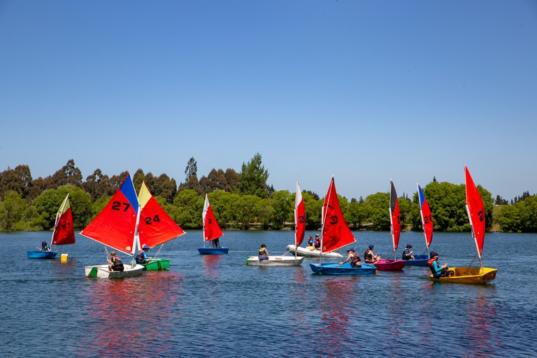 Students receive sailing lessons at Lake Rua in Canterbury, New Zealand