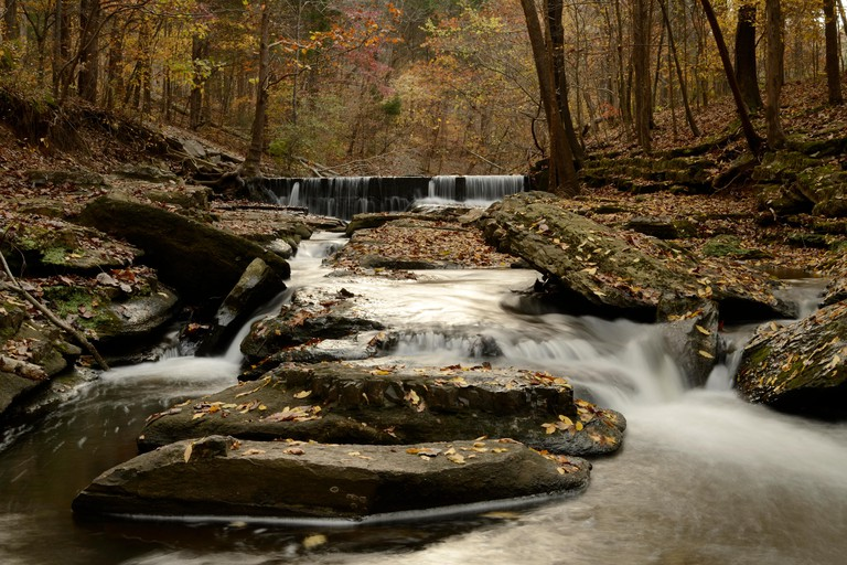 Dam and Waterfall at Montgomery Bell State Park, Dickson, Tennessee - a short drive west of Nashville. White rushing water and peak fall foliage.