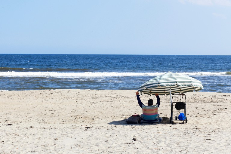 Enjoying a day at the beach, at Fort Tilden Beach in the Rockaways, New York City. Image shot 08/2018. Exact date unknown.