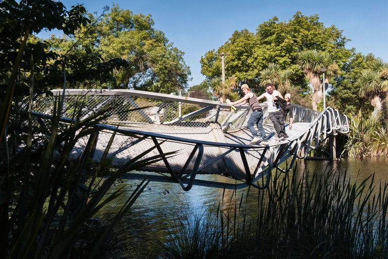 Locals using a quake damaged bridge over the Avon River east of Christchurch Red Zone one year after the February '10 earthquake