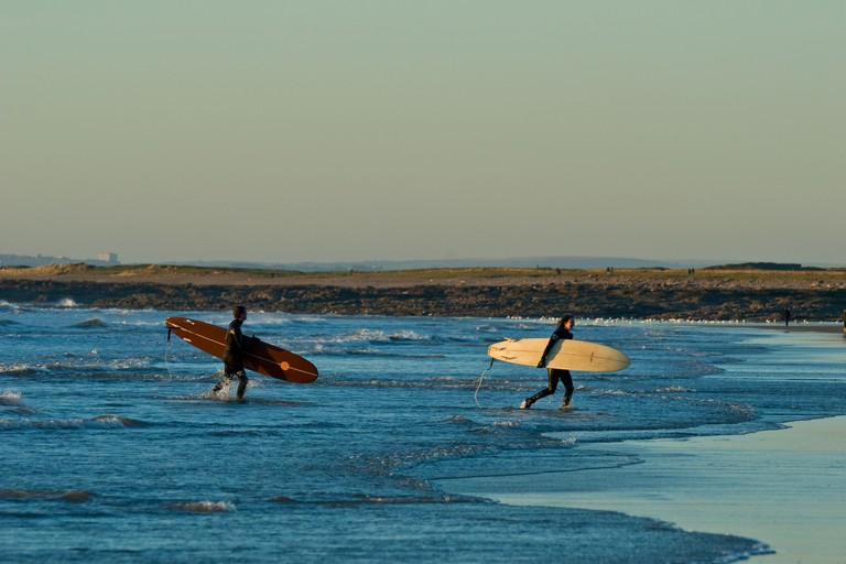 Surfers on the beach at Rest Bay on the Glamorgan Heritage Coast in Wales.. Image shot 12/2008. Exact date unknown.