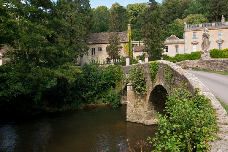 Old bridge at Iford Manor, by the River Frome, in Wiltshire, near Bath.