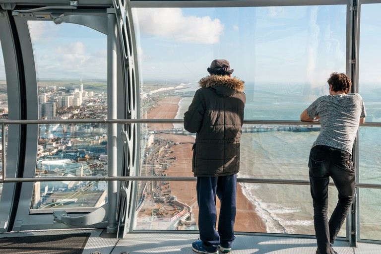 Visitors enjoying the view from the British Airways i360 observation tower on Brighton seafront.  View to east.