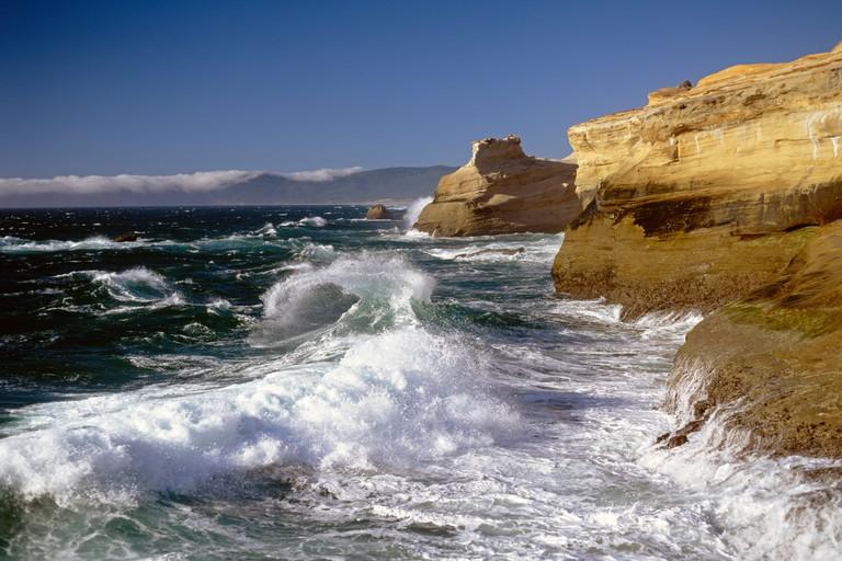 Cape Kiwanda State Park National Recreation Area big waves breaking onto rocky cliffs Northern Oregon Coast Oregon State USA