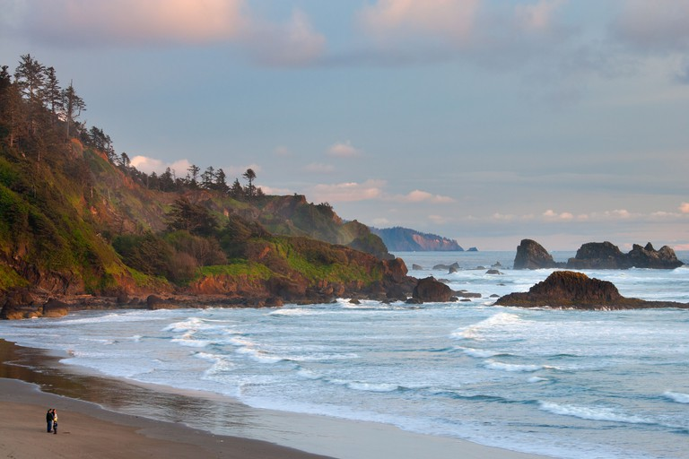 five people watching the sunset on Indian Beach and the Oregon Coast, Ecola State Park, Oregon