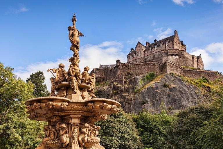 The Ross Fountain in Princes Street Gardens, and Edinburgh Castle, Scotland, UK.