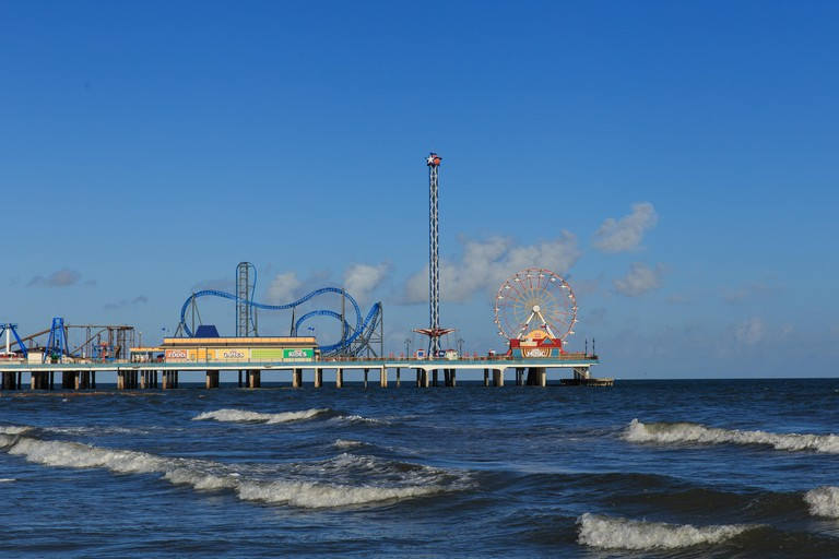 The Pleasure Pier extends over the sea and has rides and attractions in Galveston, Texas, USA.. Image shot 2016. Exact date unknown.