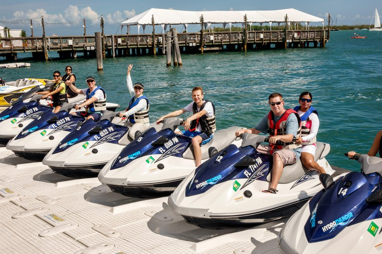 Florida Key West Gulf of Mexico jet ski wave runner rentals for rent man woman couple before excursion water dock