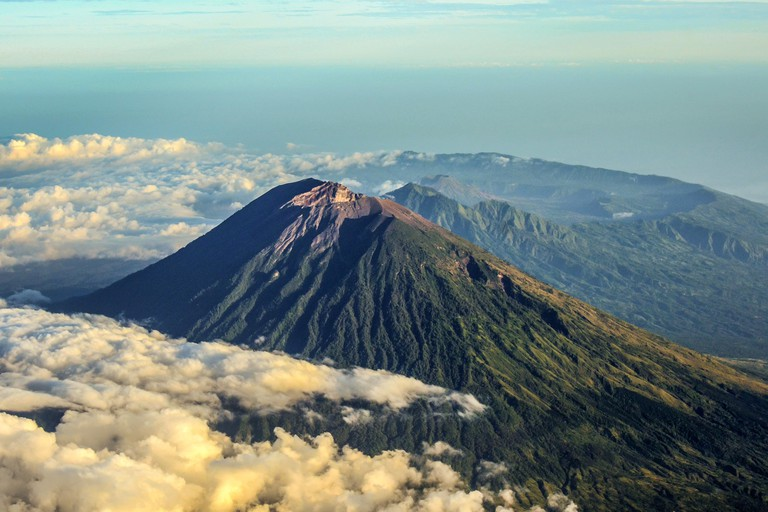 Mount Agung and the blanket of cloud with mount Abang and mount Batur in the Background.