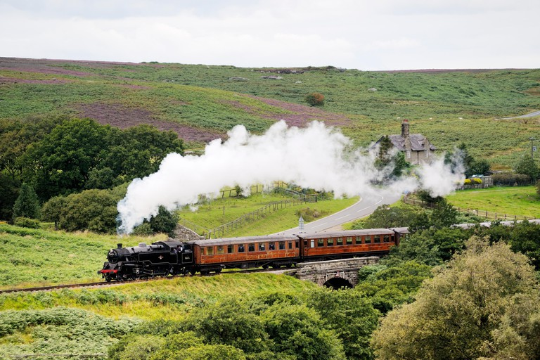 North Yorkshire Moors Railway. Vintage steam locomotive railway engine No.80072 pulls train south from Goathland, England, UK