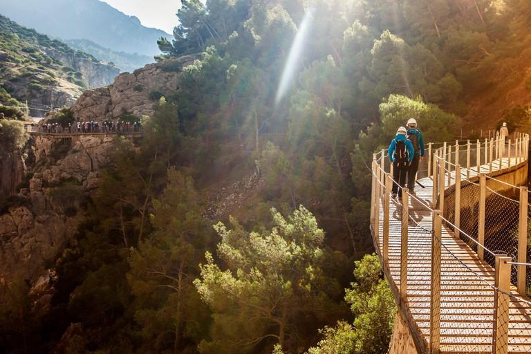 Visitors walking along the footbridge of Caminito del Rey path, Malaga, Spain.