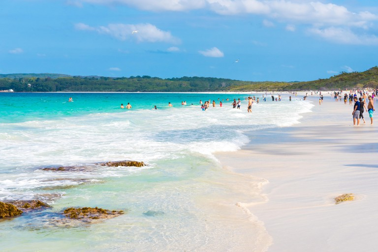 Hyams Beach, NSW, Australia-March 31, 2018: People enjoying the sunny weather at Hyams Beach with fine white sand, a charming seaside village.