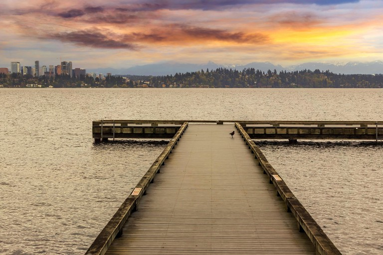 The Dock at Madrona Beach on Washington Lake in Seattle during sunset.