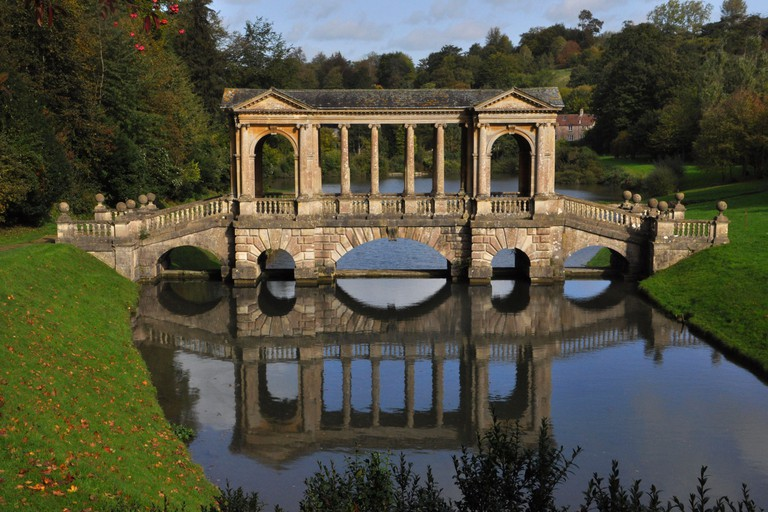 The Palladian bridge over the lake in  Priory Park gardens in Bath.Designed in the 18th century by Alexander Pope and landscape gardener Capability Br
