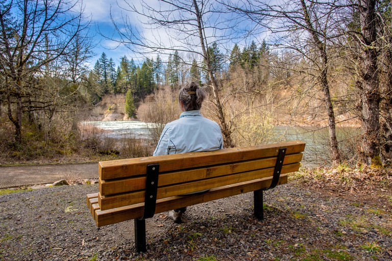 Relaxing on a park bench in Milo McIver state park Oregon.