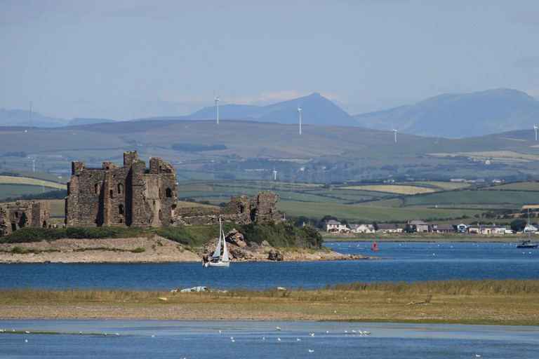 Piel Island and Piel Castle viewed from South Walney Nature Reserve, Walney Island, Barrow-In-Furness, Cumbria UK England. Furness Peninsula Summer.