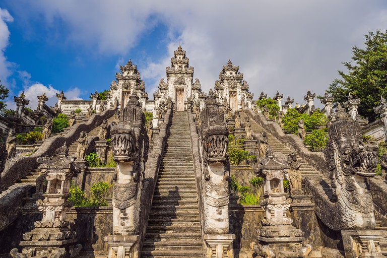 Three stone ladders in beautiful Pura Lempuyang Luhur temple. Summer landscape with stairs to temple. Paduraksa portals marking entrance to middle